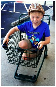 boy in shopping cart