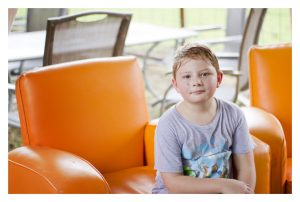 boy on orange chair